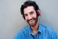 Happy man listening to music with headphones Royalty Free Stock Photography