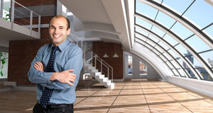Happy man in a loft royalty free stock image