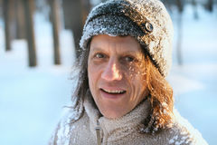 Happy man with long hair in the park in winter stock photos