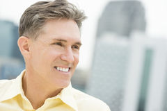 Happy Man Looking Away Outdoors. Close-up of happy mature man looking away outdoors Stock Image