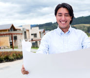 Happy man looking at blueprints Stock Image