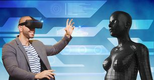 Happy man looking at 3d female figure through VR glasses Stock Images