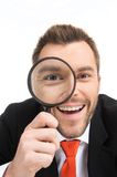 Happy man looking through magnifying glass. Royalty Free Stock Photo
