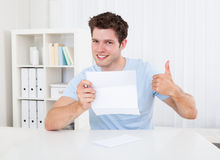 Happy Man Looking At Paper Royalty Free Stock Image