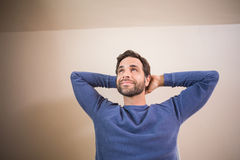 Happy man looking up. In his home Royalty Free Stock Image