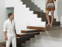 Happy Man Looking At Woman On Stairs Royalty Free Stock Images