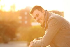 Happy man looking at you in a balcony in winter Royalty Free Stock Images