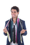 Happy man with lot of ties around his neck Royalty Free Stock Image