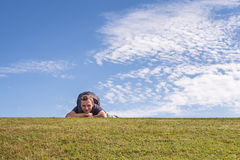 Happy man lying down on green field Royalty Free Stock Photo