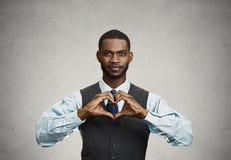 Happy man makes heart using fingers Stock Photo