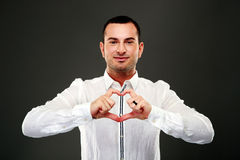 Happy man making heart from his hands Stock Photography