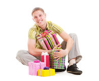 Happy man with many gift boxes. Portrait of happy man with many gift boxes Royalty Free Stock Images
