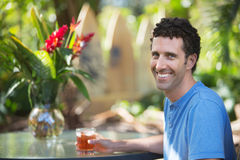 Happy Man in Maui with Drink Royalty Free Stock Images