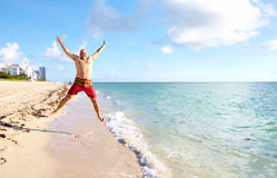 Happy man on Miami beach. royalty free stock photos