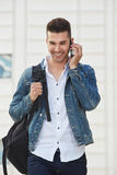Happy man on mobile phone call standing and laughing. Portrait of happy man on mobile phone call standing and laughing Stock Photos