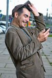 Happy man with mobile phone outdoors Royalty Free Stock Image