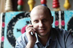 Happy man with mobile phone Stock Photography