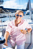 Happy man in modern clothes on a boat Stock Images