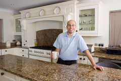 Happy man in modern kitchen Stock Image