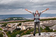 Happy man on the mountain Royalty Free Stock Image
