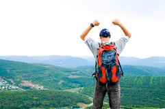 Happy man on the mountain Royalty Free Stock Photo