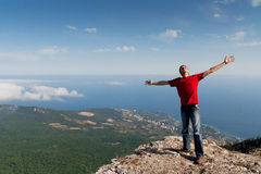 Happy man on the mountain. Freedom Stock Photography