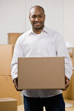 Happy man moving into new home Stock Photo