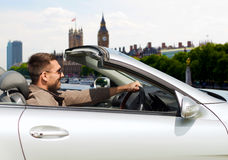 Happy man near cabriolet car over london city Royalty Free Stock Photography