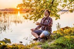 Happy man near lake Royalty Free Stock Image