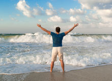 Happy man near Mediterranean sea Stock Photos