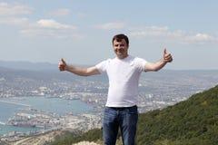 Happy man on Novorossiysk background Royalty Free Stock Images
