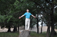 Happy man in the oak forest Stock Image