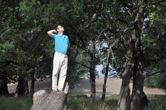 Happy man in the oak forest Stock Images