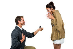 Happy man offering engagement ring to partner Stock Images