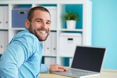 Happy man in office Stock Photos