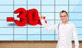 Happy man in office. Happy man pointing at discount on plasma wall Stock Images