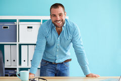 Happy man in office stock photos