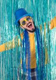 Happy man with open arms. Brazilian wears a top hat, sunglasses,. Caucasian man opens his arms. Happiness. Brazilian is wearing blue top hat, yellow sunglasses Stock Image