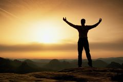 Happy man with open raised arms Gesture of triumph. Satisfy hiker  silhouette Stock Images