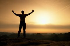 Happy man with open raised arms Gesture of triumph. Satisfy hiker  silhouette Stock Image