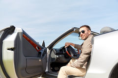Happy man opening door of cabriolet car outdoors Royalty Free Stock Image