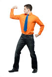 Happy man in orange shirt and blue tie. Stock Photos