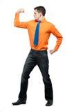 Happy man in orange shirt and blue tie. Stock Photos
