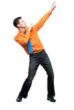 Happy man in orange shirt and blue tie. Stock Photo