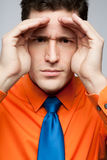 Happy man in orange shirt and blue tie. Royalty Free Stock Images