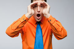 Happy man in orange shirt and blue tie. Stock Images