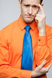 Happy man in orange shirt and blue tie. Royalty Free Stock Photo