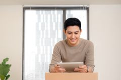 Happy man organize relocation in his new apartment.  stock photography
