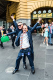 Happy man outside Flinders Street Station after Melbourne Cup Stock Photo