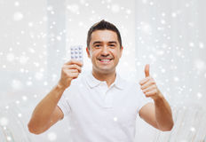 Happy man with pack of pills showing thumbs up Stock Photos